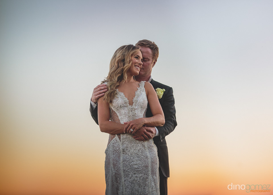 sunset wedding photo at el dorado in los cabos mexico by dino go