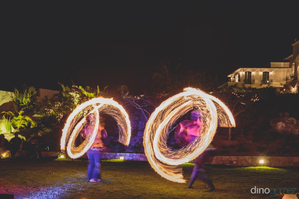 dino gomez cabo wedding videographer records fire dancers at des