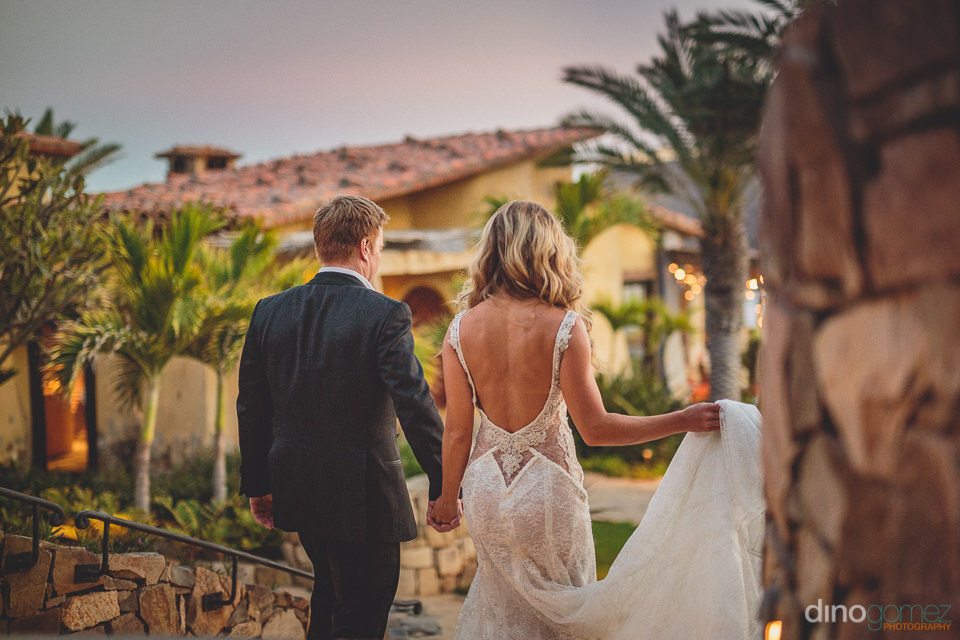 newlyweds walk around el dorado luxury resort in los cabos mexic