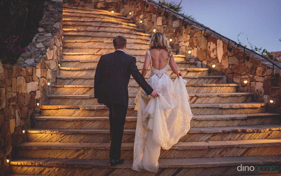 newlyweds walk up the steps to the clubhouse at el dorado golf a