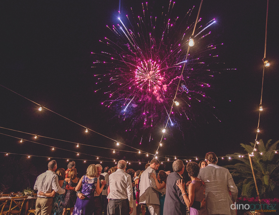 wedding guests watch special wedding fireworks at el dorado golf