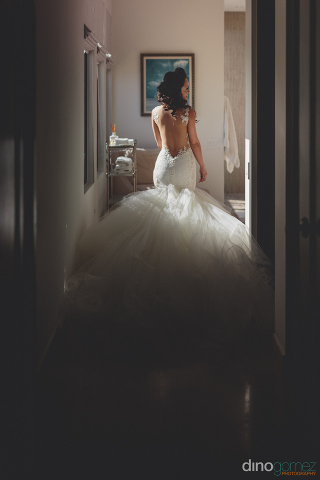 bride walks down hallway of jw marriott hotel puerto los cabos