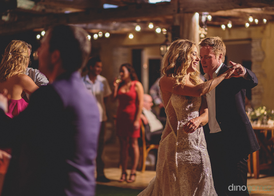 guests and newlyweds dancing in cabo san lucas