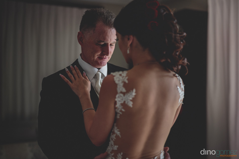 Groom Looks At Bride With Awe On Their Wedding Day In Cabo San L