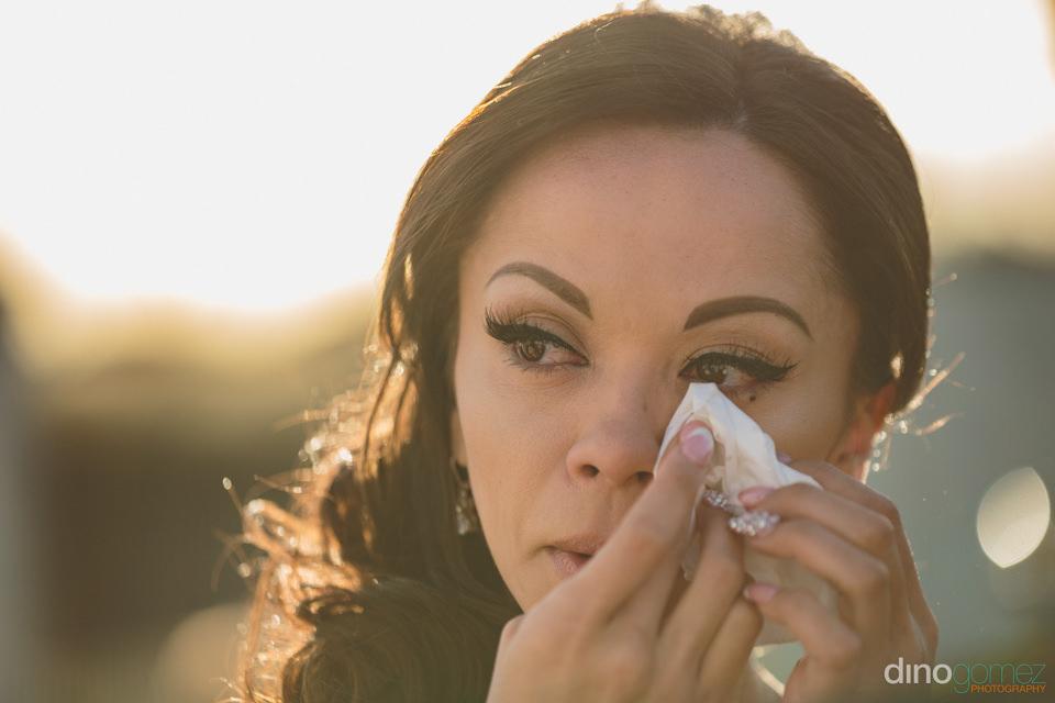 bride cries tears of joy at wedding ceremony at villa paradiso p