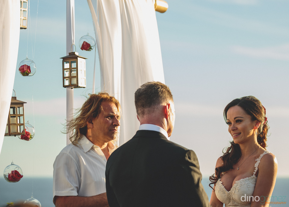groom reads vows during wedding ceremony at luxury villa in mexi