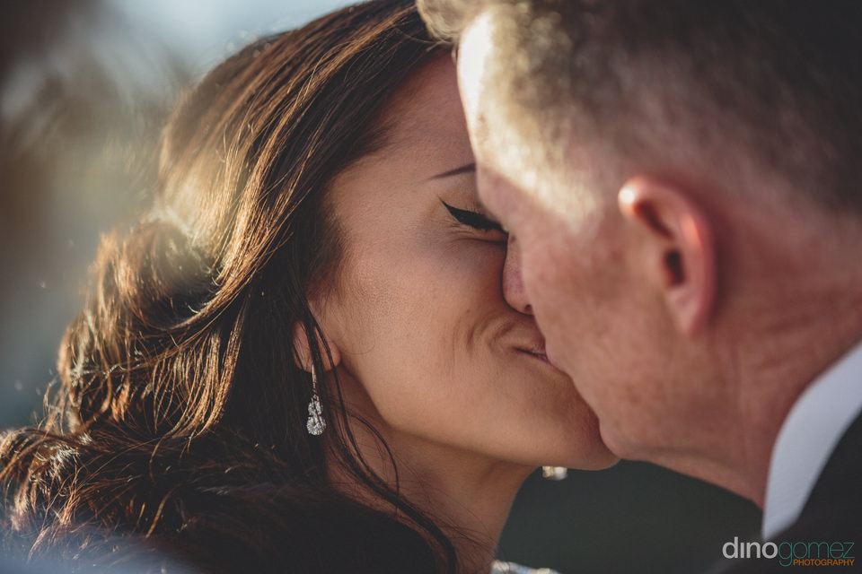 newlyweds kiss as they are pronounced husband and wife