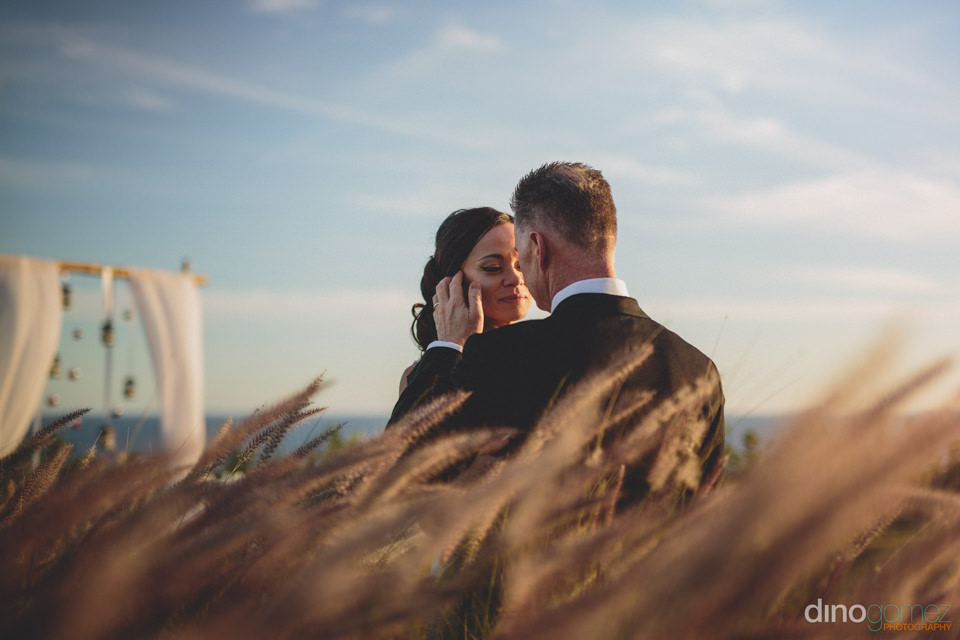 bride and groom in natural photo by dino gomez in cabo san lucas