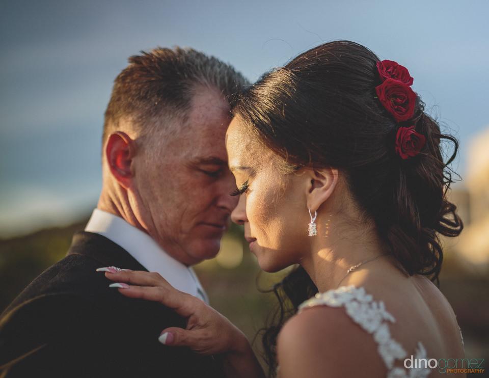 romantic wedding photo of classy newlyweds