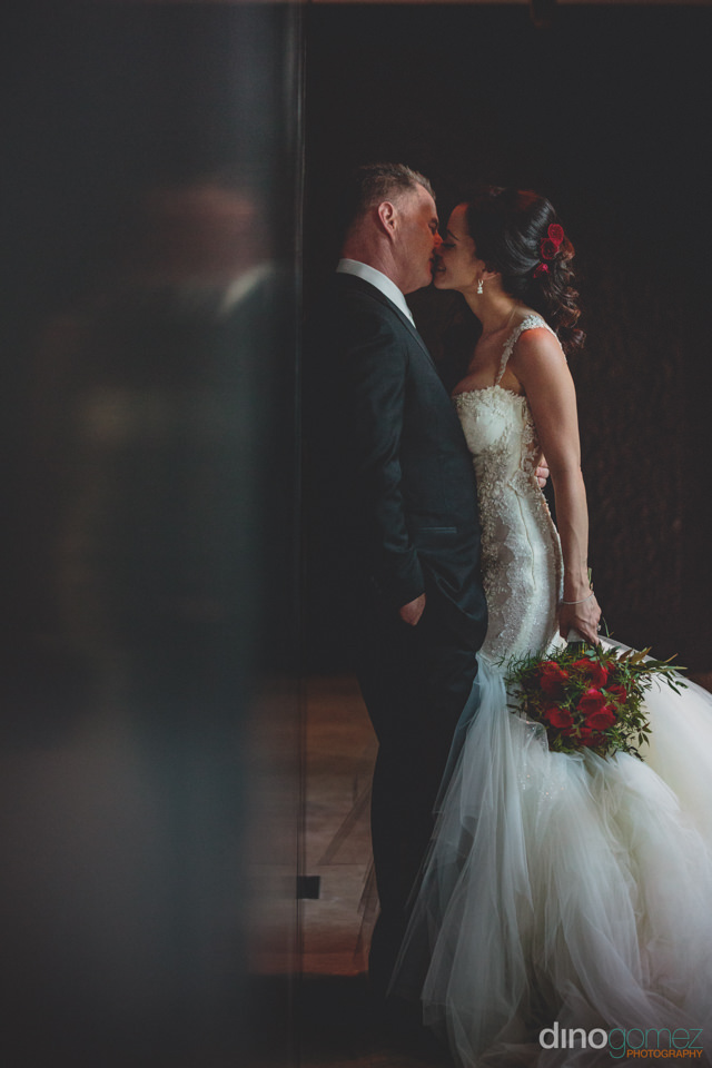 Affectionate Newlyweds Kiss Indoors Photo By Dino Gomez