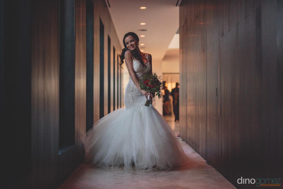 stunning bride in hotel hallway photo by dino gomez