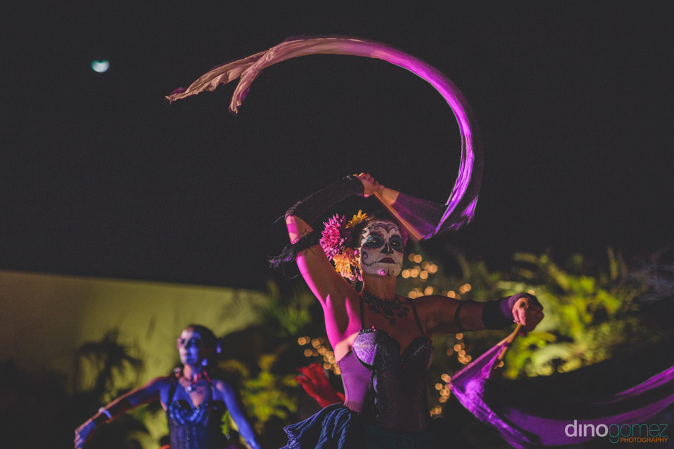 day of the dead mexican circus dancers perform at wedding