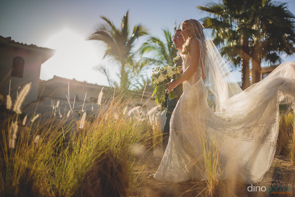 father walks daughter to wedding ceremony at el dorado los cabos