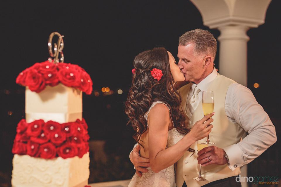 red rose wedding cake at luxury cabo wedding photo by dino gomez