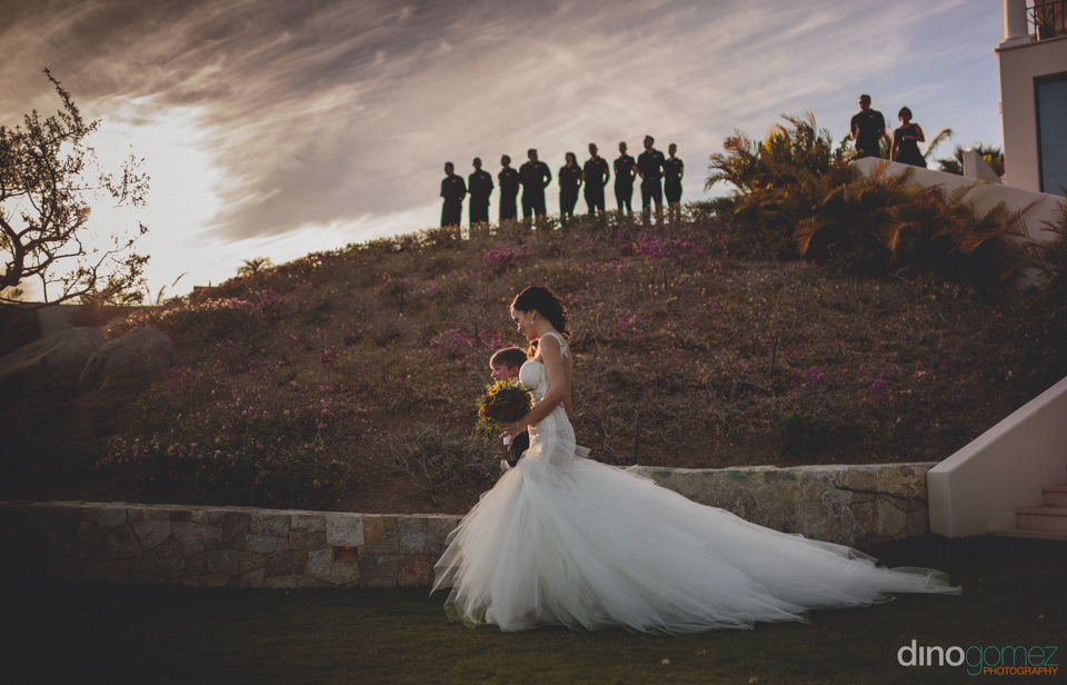Bride In Luxurious White Dress Glides To The Wedding Alter In Di