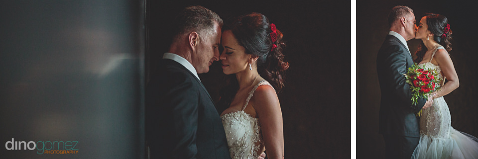 caring bride and groom kiss and show affection in wedding photo
