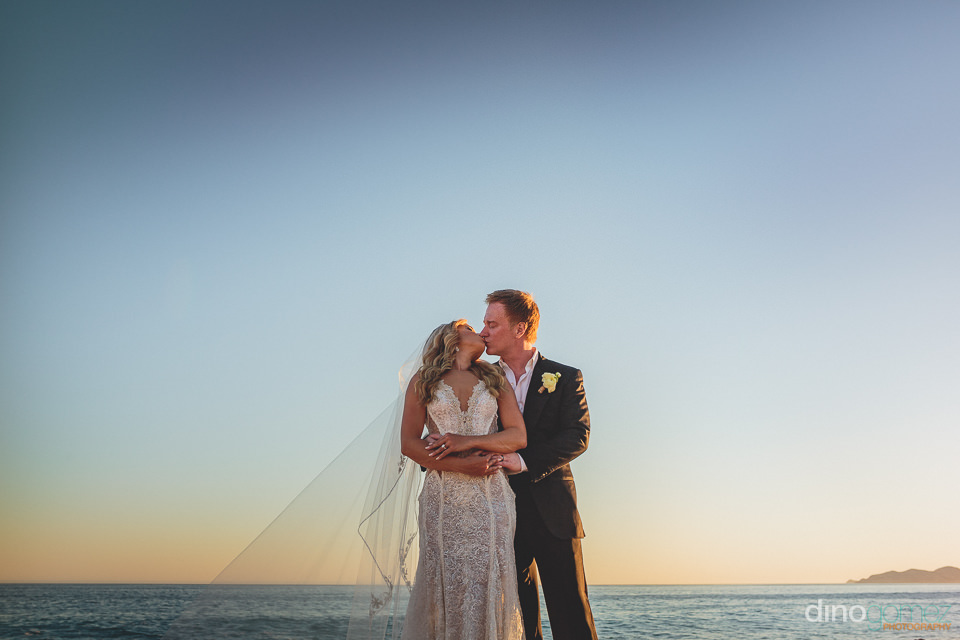 perfect beach wedding photo of newlyweds by dino gomez