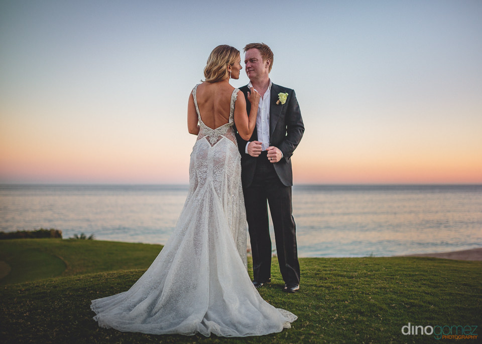 newlyweds on el dorado golf course in los cabos wedding photo by