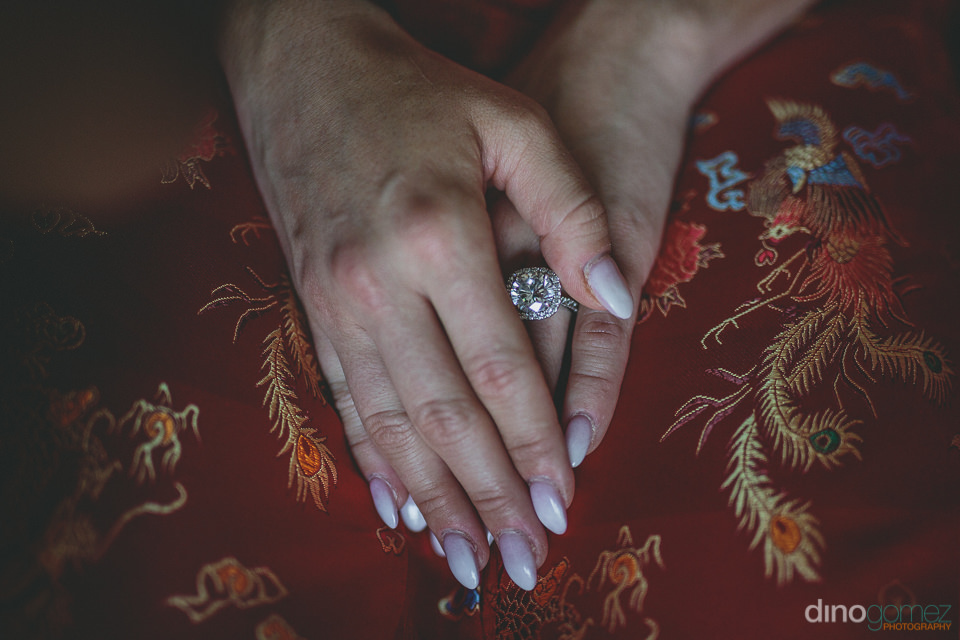 closeup of brides hands and diamond wedding ring