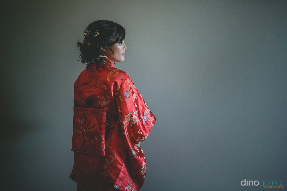 bride wore a red silk kimono before putting on her wedding dress