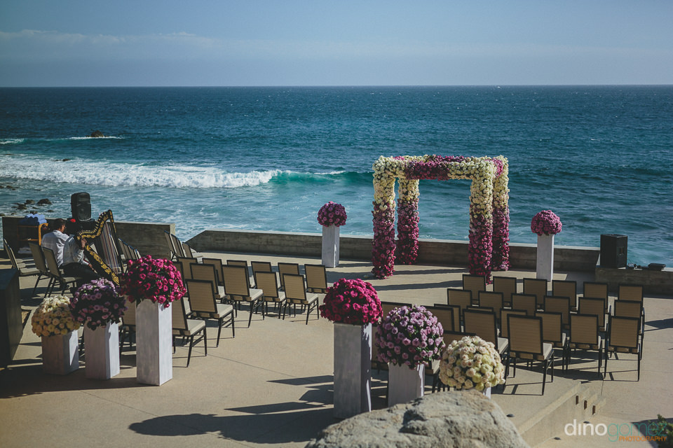 luxury beach wedding setup altar and flowers by the main event c