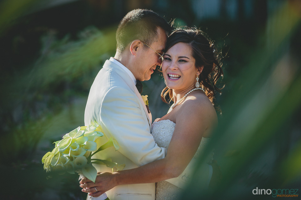 lush green scenery wedding photo by dino gomez