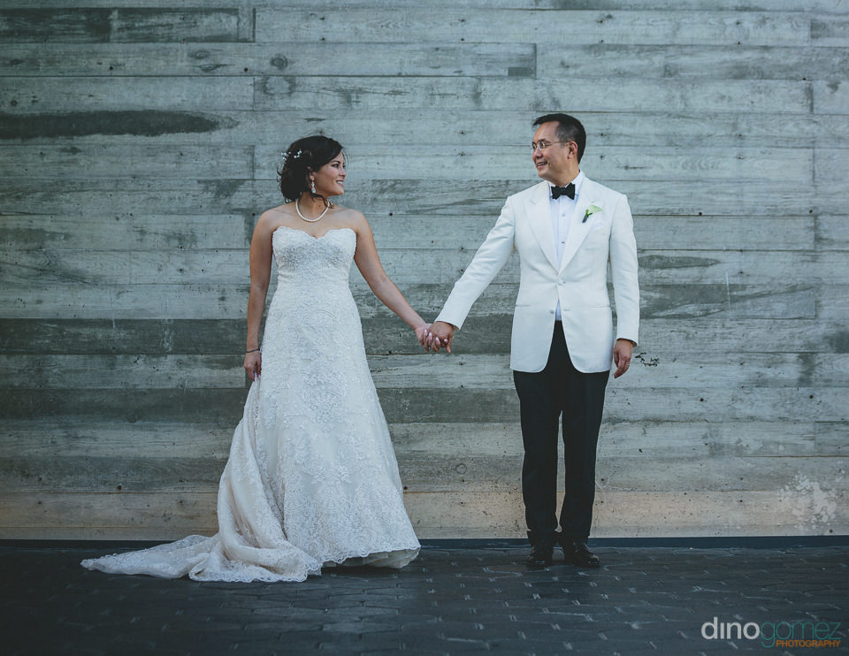 bride and groom holding hands facing forward wedding photo by ba