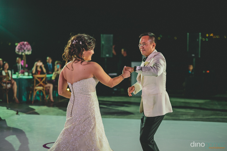 newlyweds share first dance together at los cabos wedding recept