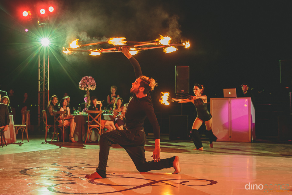 dancers twirl fire sticks acrobatics live wedding entertainment