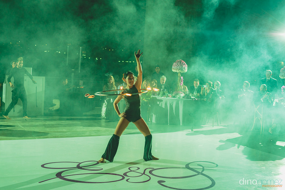 fire dancer hula hoop at cabo wedding photographed by dino gomez