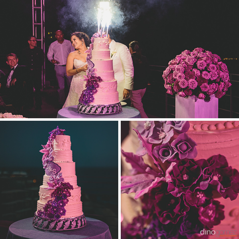 firework candles on purple rose wedding cake