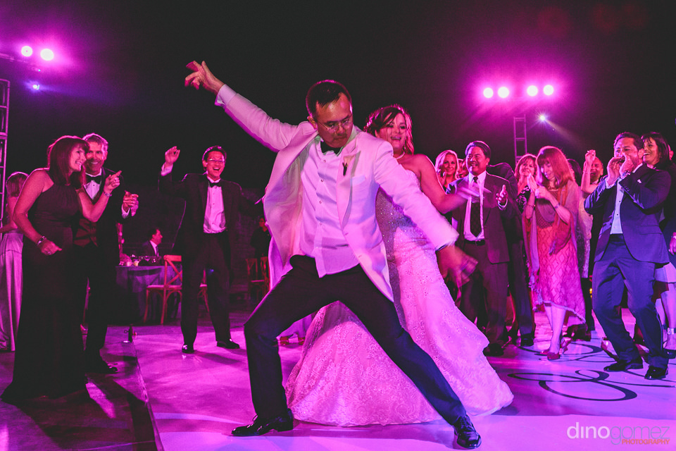 groom with great dance skills at luxury destination wedding