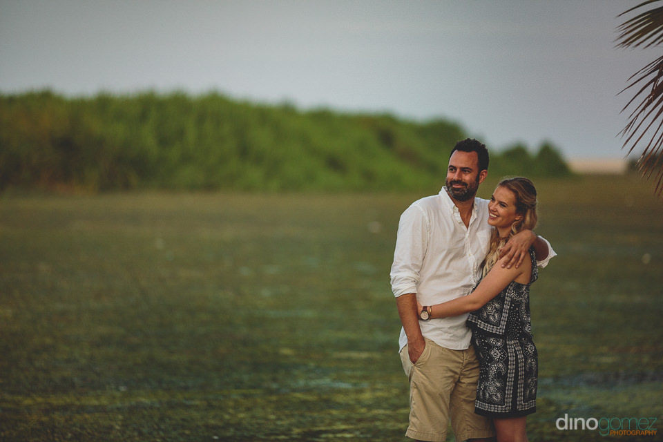 engaged couple in nature sanctuary with dino gomez