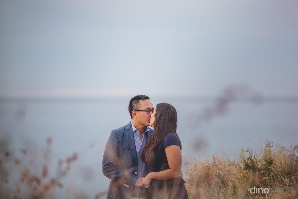 cabo wedding photographer dino gomez photo of newlyweds on the b
