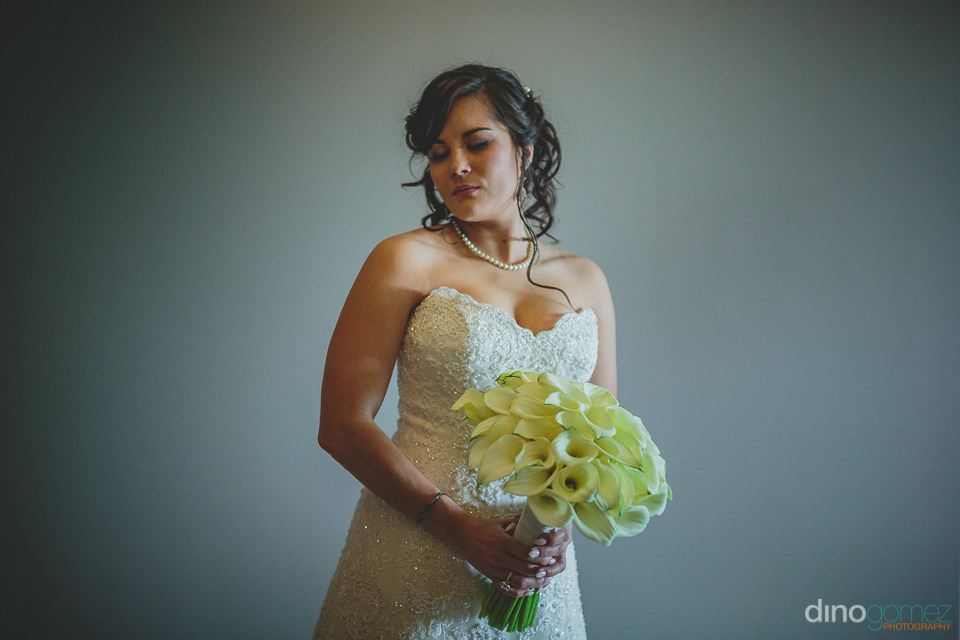 bride holds white flower bouquet at luxury destination wedding p