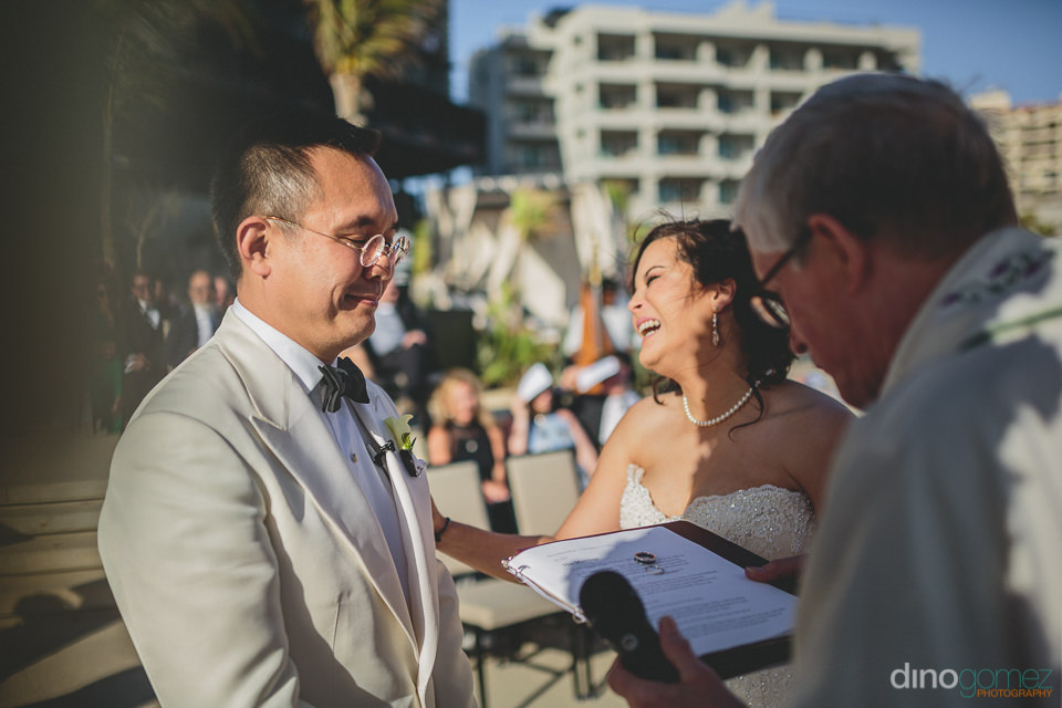 fun happy wedding ceremony photographed by dino gomez