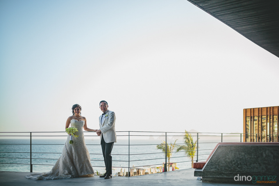 newlyweds at the cape hotel best wedding venue photos by dino go