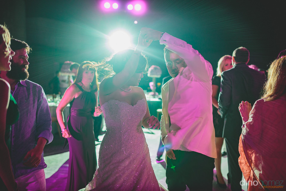 newlyweds love to dance at their destination wedding at the cape