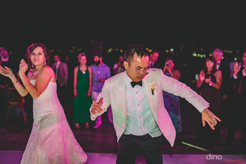 dapper groom dancing at destination wedding in cabo