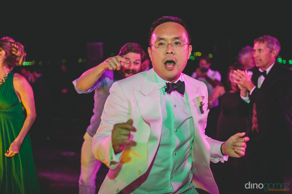 exciting fun destination wedding dancing in cabo san lucas
