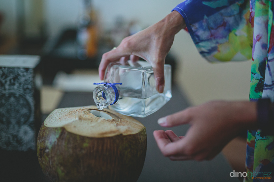making drinks in a fresh coconut in mexico