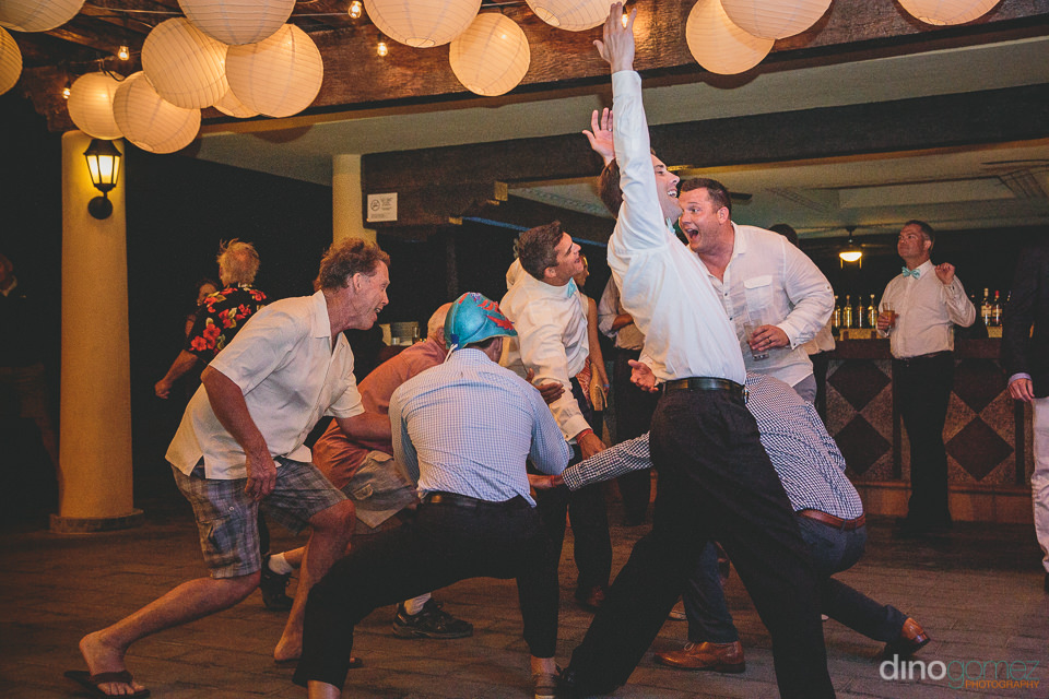 riu santa fe wedding groomsmen partying on dance floor
