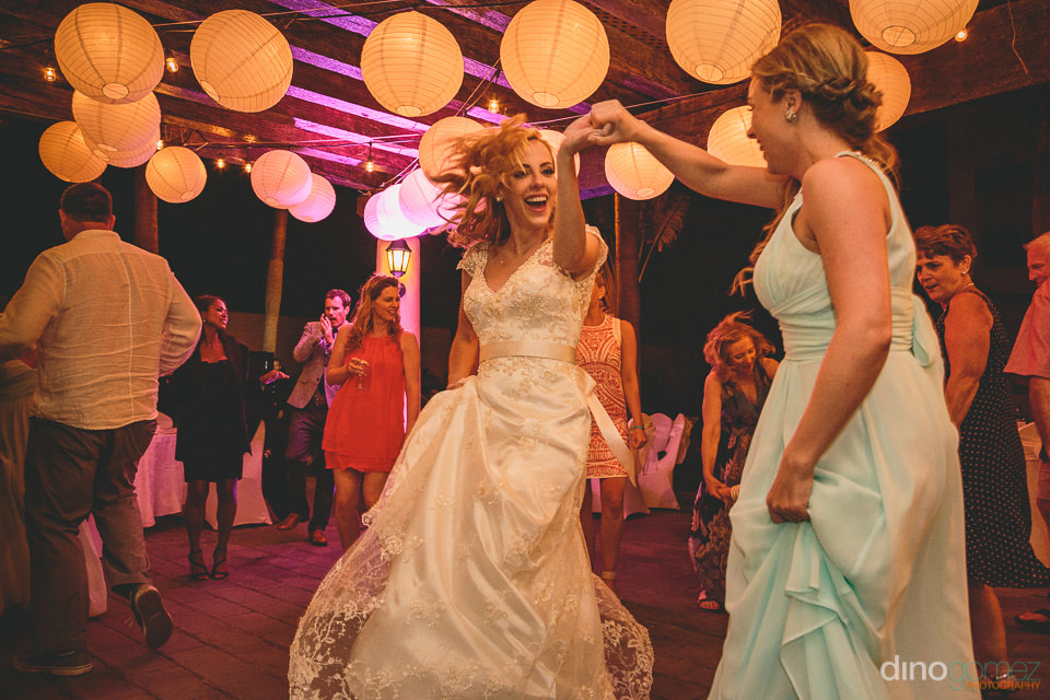 canadian bride dances at destination wedding in cabo san lucas m