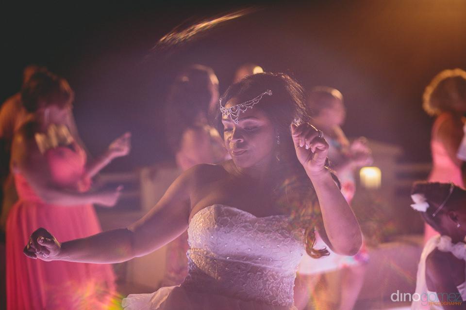 beautiful bride dances at destination wedding photographed by di