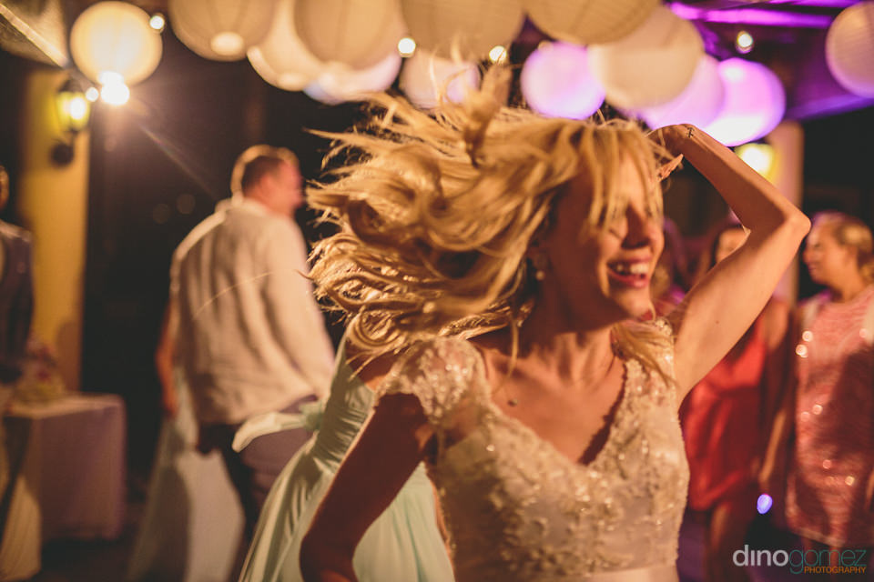 bride dances on her wedding night in cabo with photos by dino go