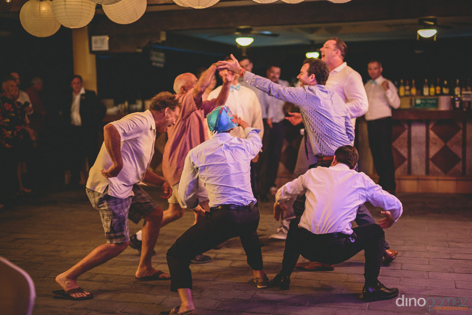 groomsmen dance and have fun at the wedding reception
