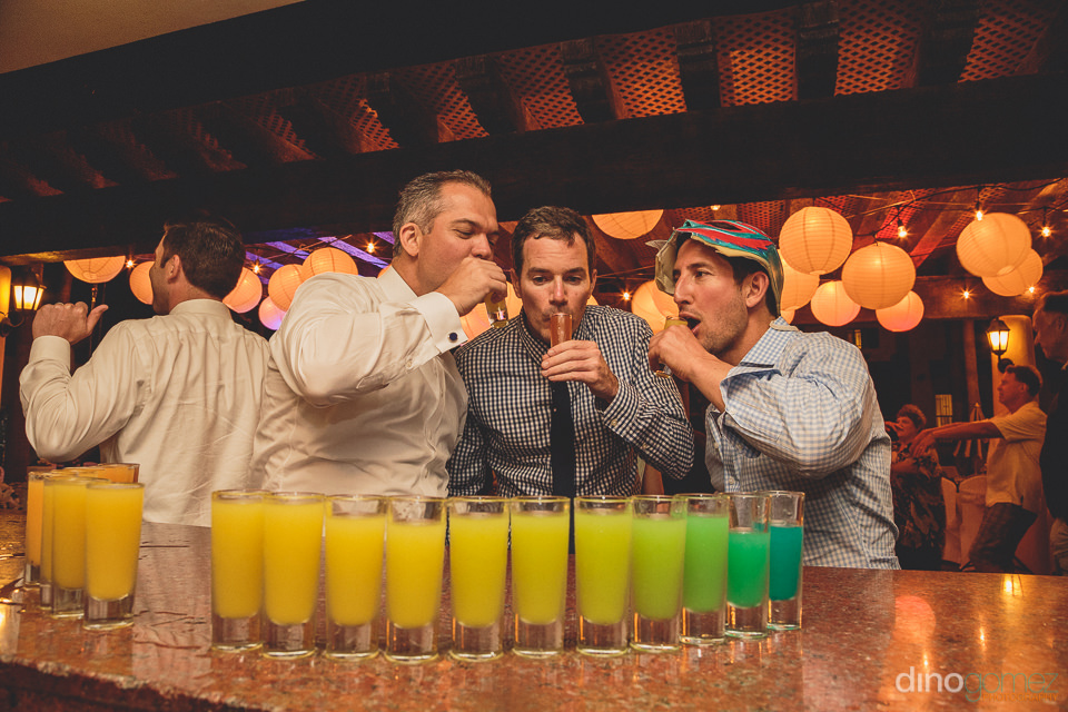 colorful shots lined up on the bar at cabo san lucas resort wedd