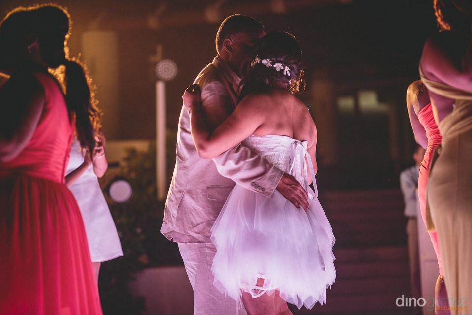 deep in love newlyweds dance romantically at wedding reception i
