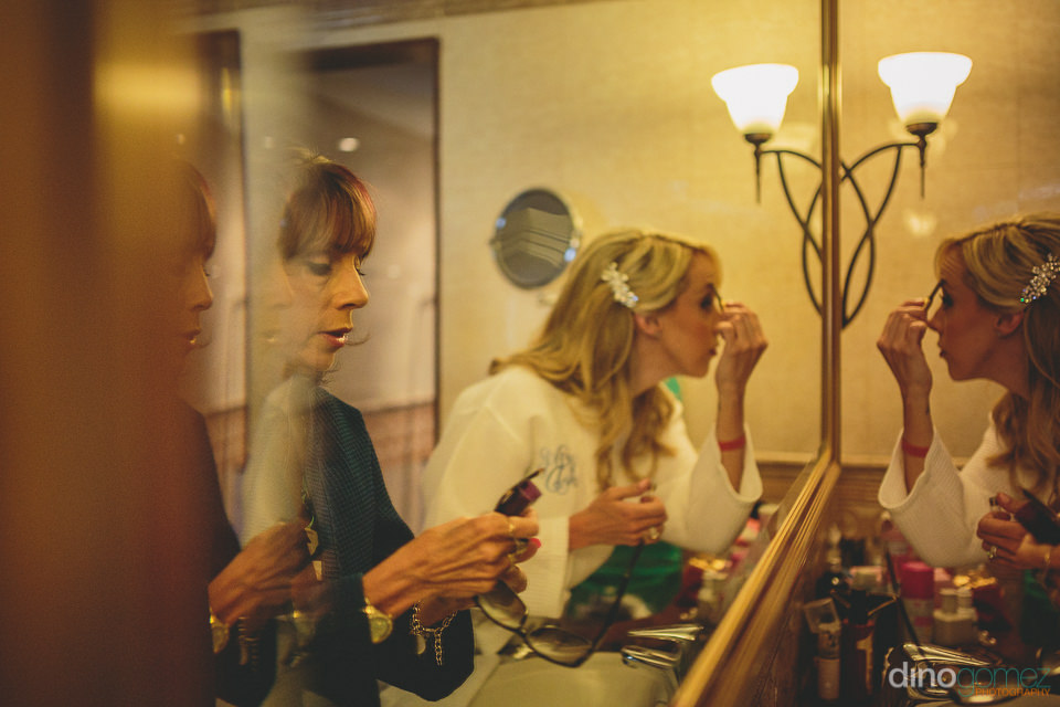 bride puts on makeup before destination wedding photographed by