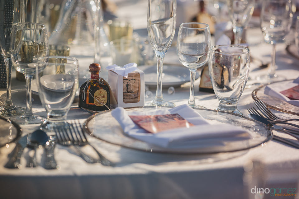 small bottle of don julio tequila at mexican wedding place setti